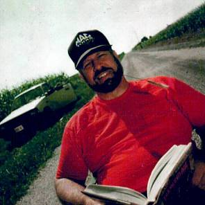 Michael Hart with Book, in cap and red shirt